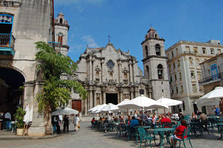 Havana, Cuba - January 2009: restaurant and cathedral in havana square