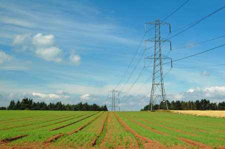 electricity pylons along agricultural field in Shropshire, UK Stock Photo - 10042607