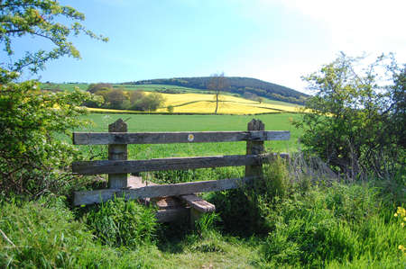 stile: countryside fields and stile on shropshire walk Stock Photo