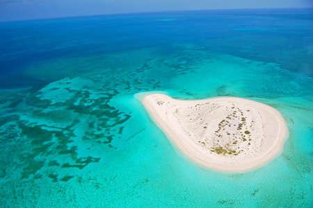 beautiful deserted island in coral reef ocean