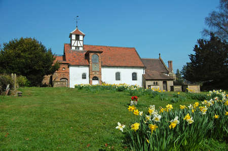 worship service: view of english country village church in springtime Stock Photo