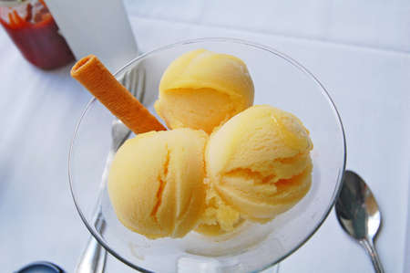 mango sorbet in glass dish at table Stock Photo - 13592683