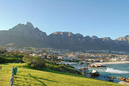 mountain peaks overlooking camps bay, cape town, south africa photo