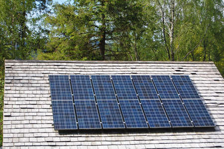 solar panels fitted to slate roof on country cottage Stock Photo - 13750133