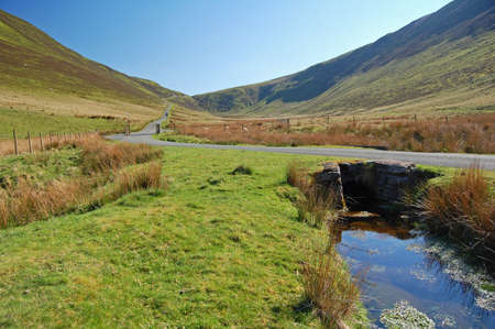 road and stream in Snowdonia National Park, Wales Stock Photo