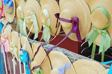 rows of straw bonnets on display Stock Photo - 16303303