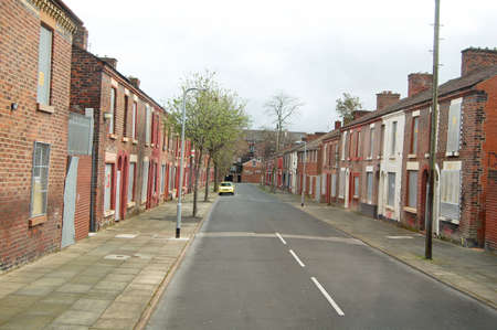 street of derelict houses in england condemned for demolition Stock Photo