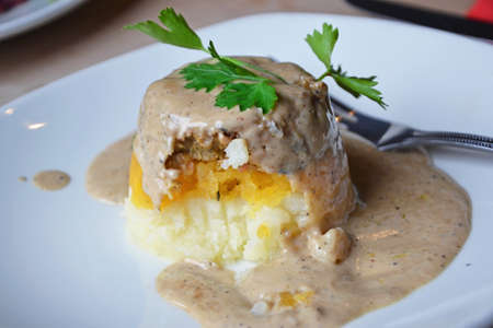 a starter meal of vegetarian haggis with a peppercorn sauce