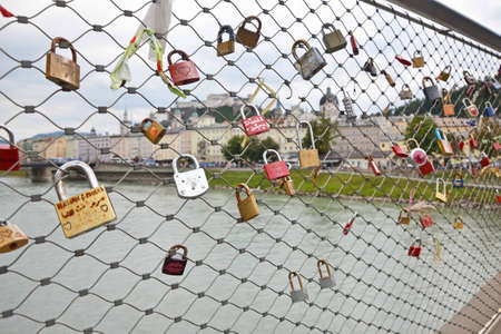 SALZBURG, AUGUST 13   Padlocks on bridge in Salzburg, Austria, August 13, 2013  Lovelocks are left by sweethearts on bridges to symbolise their love, a global craze which started in the early 2000s