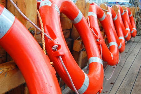 row of life buoys on boat Stock Photo
