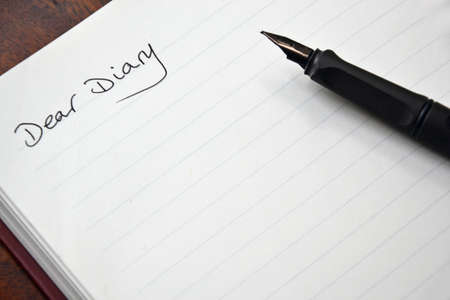 biography: diary entry open on blank page and pen