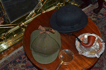 fancy dress objects associated with detective work on a table photo