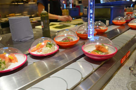 food on a conveyor belt sushi bar restaurant Stock Photo