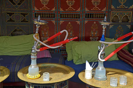 hookah pipes at outside tables at a cafe Stock Photo