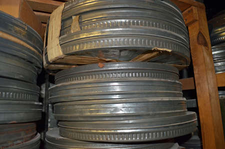 a stack of 35mm movie film canisters Stock Photo