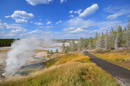 view of Norris Geyser Basin and rainbow in Yellowstone National Park, Wyoming, USA Stock Photo