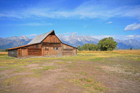 view of the Grand Tetons with historic barn in foreground