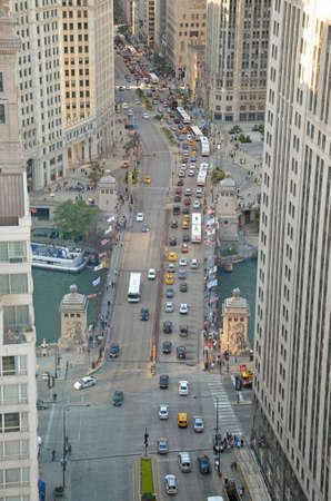 michigan avenue: Chicago - August 12: aerial view of commuter traffic along the Magnificent Mile and Michigan Avenue Bridge in Chicago, USA, on August 12, 2015. The bridge links the north shopping area to the southern Loop district.
