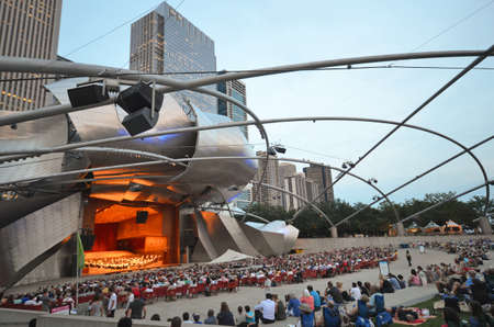 Chicago - August 14: A concert performance at the Jay Pritzker Pavilion in Chicago, USA, on August 14, 2015. The Pavilion, designed by Frank Gehry, is an outdoor performing arts venue.