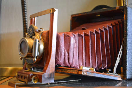 bellows: vintage wooden framed folding camera with red bellows