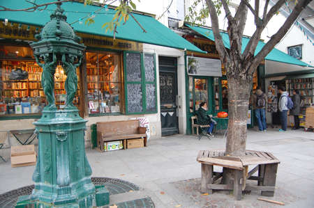 Paris, France - October 30, 2012: people outside the famous Shakespeare bookstore in Paris, France. Opened by George Whitman in 1951, the bookshop is a popular tourist attraction.