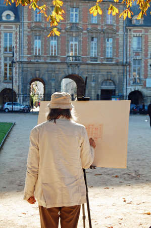 Paris - October 31, 2012: an artist with easel in a Paris square, France. Many street artists can be found in Paris which has attracted famous artists including Picasso and Dali. Editorial
