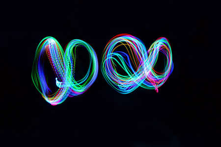 Two infinity signs on black background Stock Photo