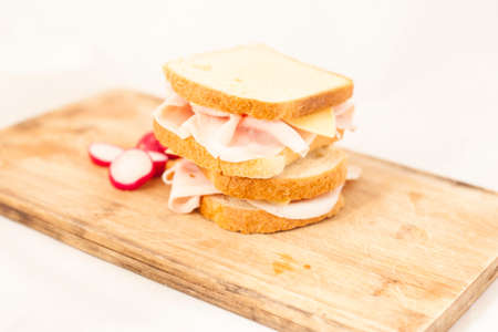 Toast with ham and cheese on a wooden cutting board photo