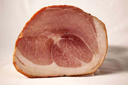 Typical italian cooked ham on a white background in the studio.