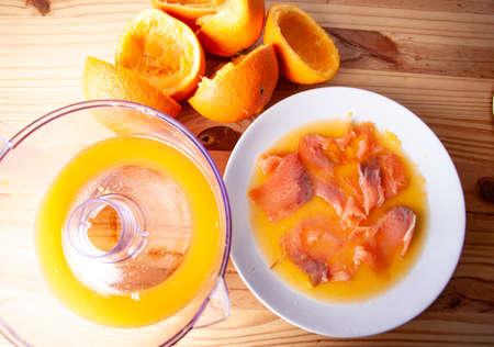 Norwegian orange juice smoked salmon, phases of the recipe in the studio.