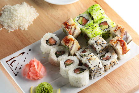 fresh and tasty sushi on bright background Stock Photo