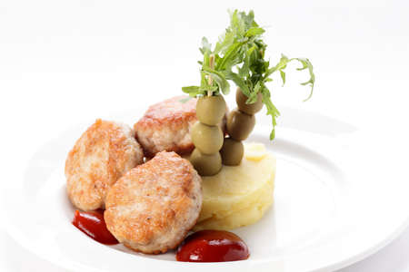 cold cutlets with garnish on white background
