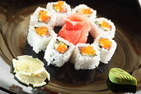 cold sushi on black dish and white background photo