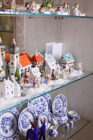 Brand new hollyday toys and dishes on the shelfes photo