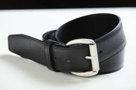 black belt on white table photo
