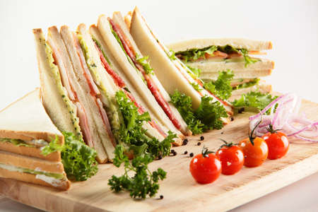 fresh sandwiches on wooden desk and white background photo
