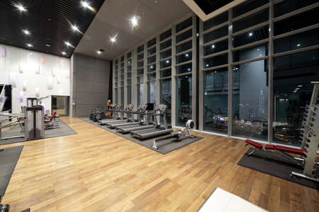 fitness club: bright european gym with a lot of windows