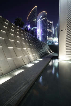 modern entrance to building with water in dubai photo