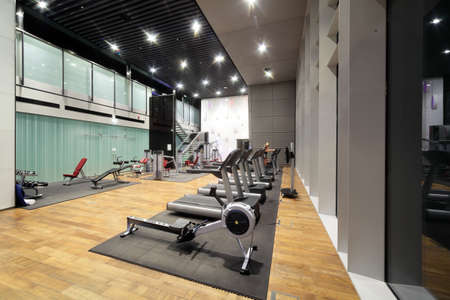 health clubs: bright european gym with a lot of windows