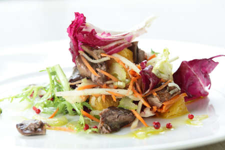 Fresh and tasty salad in white dish photo