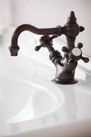 Brand new water tap on bright background photo