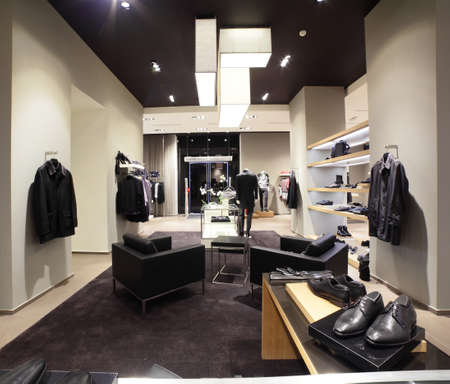 interior of brand new fashion clothes store photo