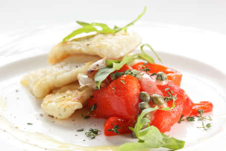 cod fish: roasted peaces of fish with garnish