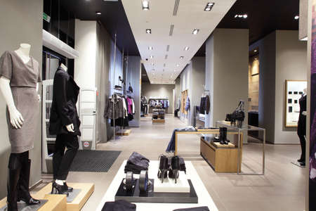 casual fashion: interior of brand new fashion clothes store