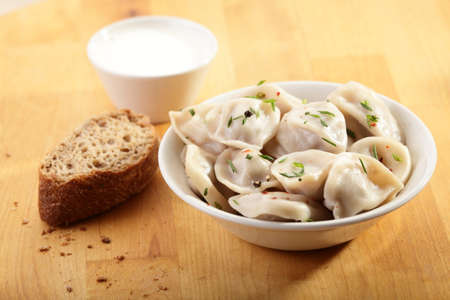 hot and tasty dumplings on a dish photo