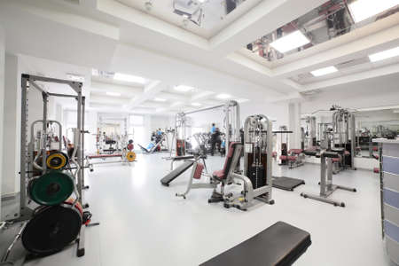 gym room: interior of new modern gym with equipment