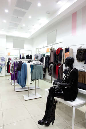 outlet store: european clothing store interior in modern mall