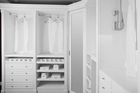 modern and stylish interior of bright wooden wardrobe photo