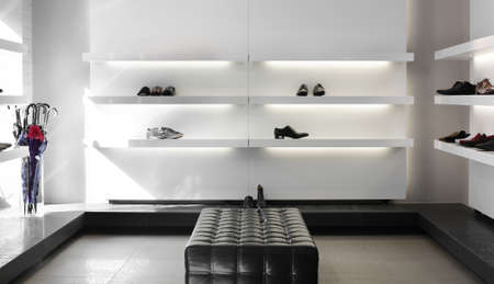 show window: bright large shoe store with luxury collection