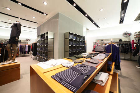 clothing store: european fashionable clothing store in beautiful mall Stock Photo